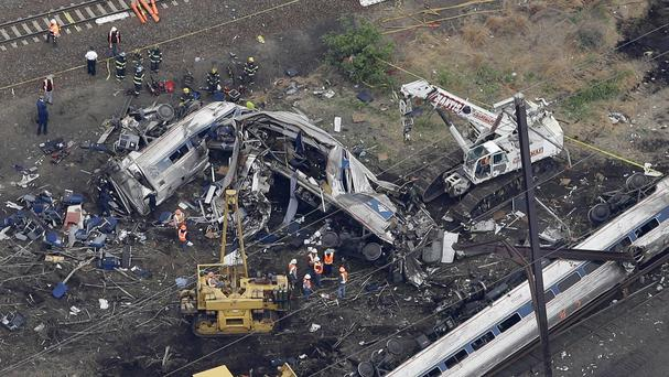 Emergency personnel work at the scene of the crash (AP)