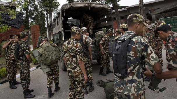 Nepalese soldiers prepare to head to the site where the suspected wreckage of a US Marine helicopter was spotted. (AP)