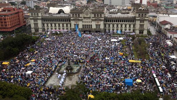 Protesters gather outside the National Palace to demand the resignation of Guatemalan president Otto Perez Molina in Guatemala City (AP)