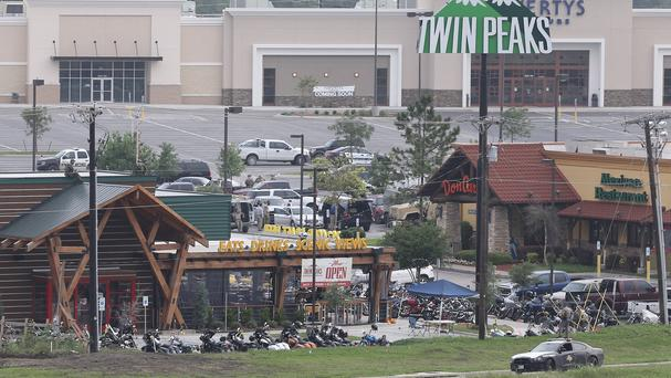 Law enforcement continue to investigate the motorcycle gang-related shooting at the Twin Peaks restaurant in Waco (AP)