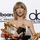 Taylor Swift poses with her prizes at Billboard Music Awards (AP)