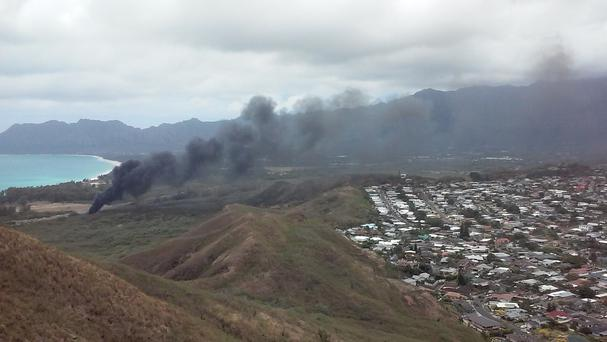 Smoke rises from a Marine Corps Osprey aircraft in Hawaii (AP)
