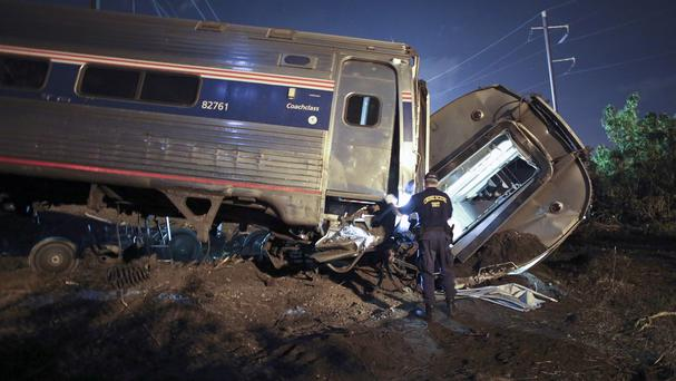 Emergency crews at the scene of the deadly train crash in Philadelphia (AP)