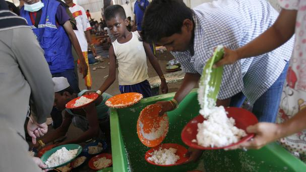 An ethnic Rohingya boy queues up for food at a temporary shelter in Langsa, Aceh province, Indonesia (AP)