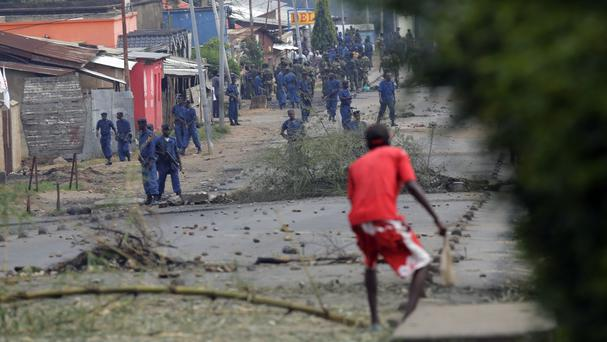 Police chase demonstrators in the Musaga neighbourhood of Bujumbura, Burundi (AP)
