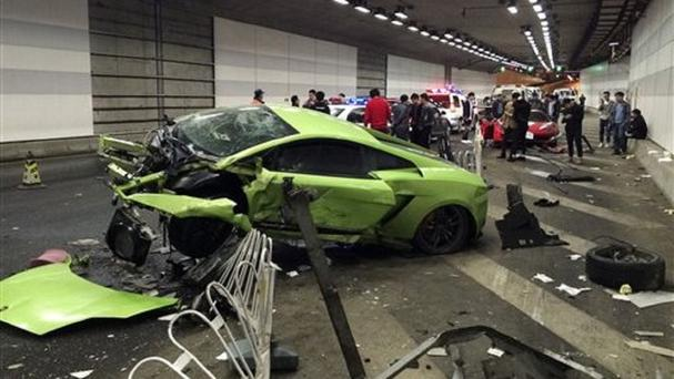 The damaged Lamborghini after it crashed with a Ferrari in a tunnel in Beijing (Chinatopix/AP)