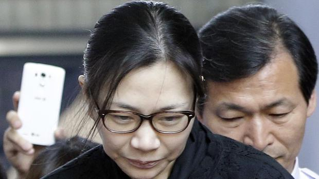 Cho Hyun-ah leaves Seoul High Court after her nut rage sentence was suspended (AP)