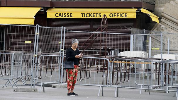 The near-deserted ticket desk at the Eiffel Tower after staff walked out. (AP)