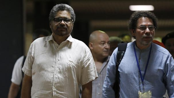 Ivan Marquez and Pastor Alape arrive for peace talks with Colombia's government. (AP)