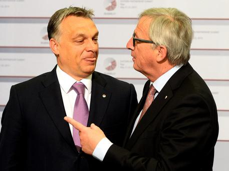 Hungarian Prime Minister Viktor Orban is greeted by President of the European Commission Jean-Claude Juncker on the second day of the fourth European Union (EU) eastern Partnership Summit in Riga, on May 22, 2015