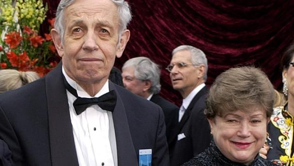 John Nash and his wife Alicia, arrive at the 74th annual Academy Awards, in Los Angeles in 2002 (AP/File)