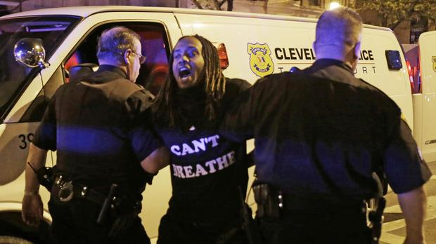 A man is arrested during the Cleveland protests (AP)