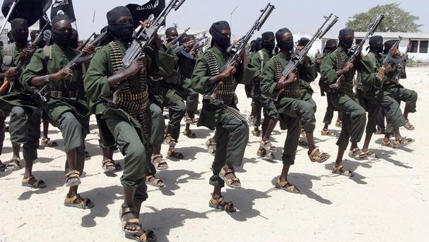 Hundreds of newly trained al-Shabab fighters perform military exercises in the Lafofe area south of Mogadishu in Somalia (AP)