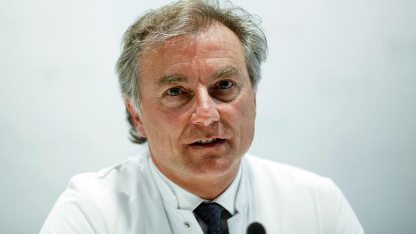 Wolfgang Henrich said the quadruplets born prematurely to 65-year-old Annegret Raunigk are still in intensive care (AP)