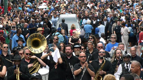 A hearse carrying the body of blues musician BB King is taken down Beale Street in Memphis, Tennessee, in a procession (AP Photo/Karen Pulfer Focht)