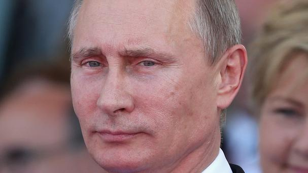 Russian President Vladimir Putin says the US is trying to derail Sepp Blatter's re-election as Fifa chief