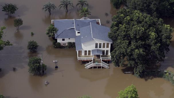 A home is surrounded by floodwaters near the San Jacinto River (AP)