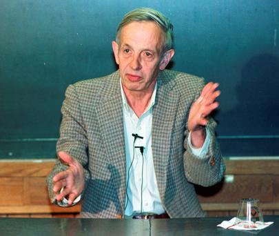 In this Oct. 11, 1994 file photo, Princeton University professor John Nash speaks during a news conference at the school in Princeton, N.J., after being named the winner of the Nobel Peace Prize for economics. Nash, whose struggle with schizophrenia was chronicled in the 2001 movie