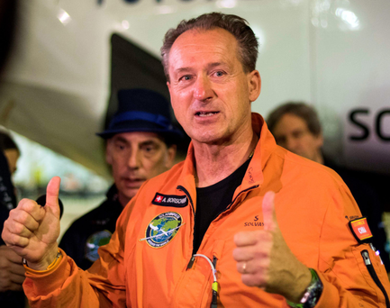 Betrand Piccard gives the thumbs up before fellow pilot Andre Borschberg takes off. Photo: AFP