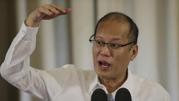 Philippine President Benigno Aquino III said charges will be filed against all those responsible for the rubber slipper factory fire that left 72 people dead. (AP)