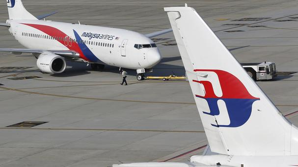 Malaysia Airlines makes emergency landing in Australia after engine fire alert went off