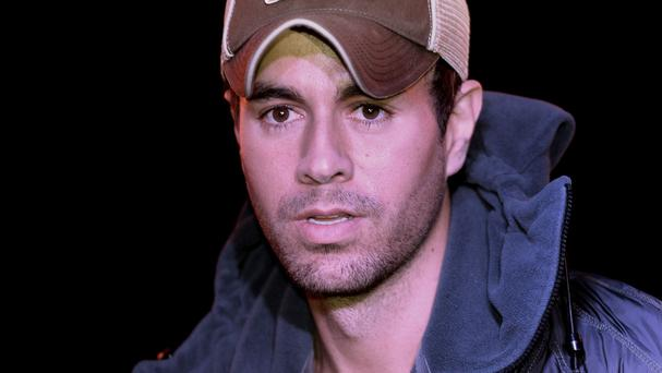 Enrique Iglesias injured his hand during a concert in Mexico