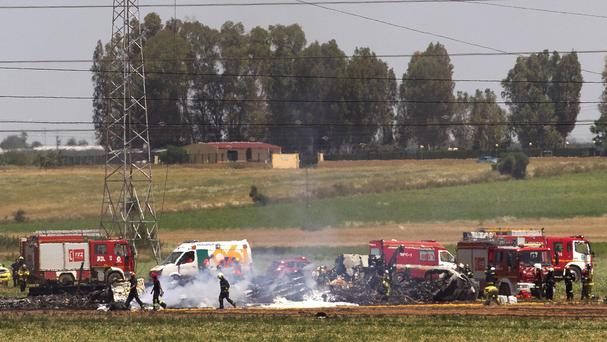 The scene of a plane crash near Seville airport in May. (AP)