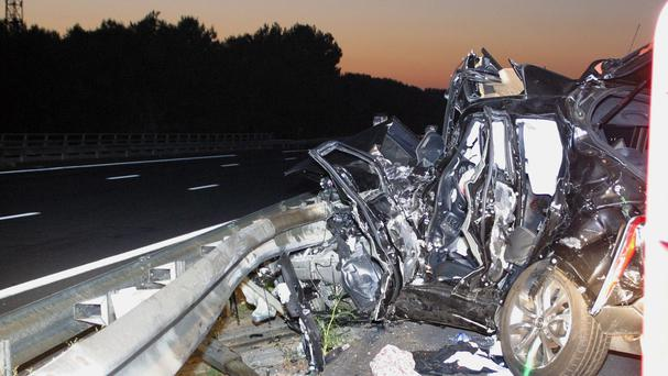 The wreckage of a car belonging to rugby player Jerry Collins on the road near Beziers. (AP)