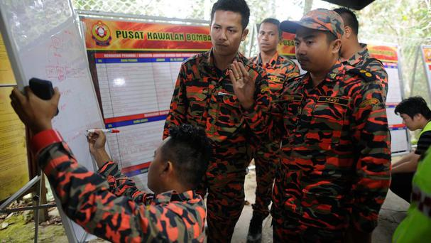 Members of the Malaysian rescue team makes plans after an earthquake (AP)