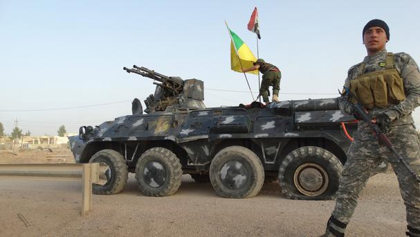 The Iraqi flag has been raised in Beiji after troops took back key parts of the town from IS