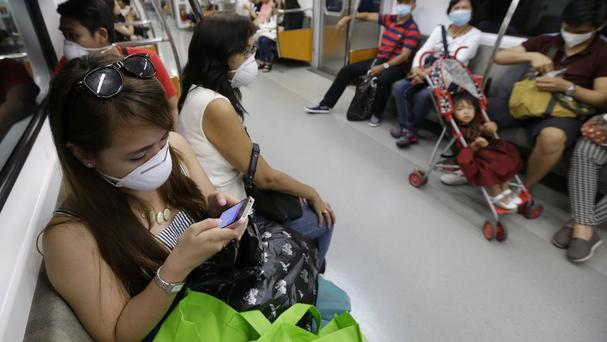 Tourists wear masks as a precaution against Mers on a subway train in Seoul, South Korea. (AP)