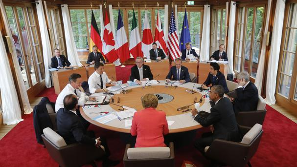 German Chancellor Angela Merkel says the G7 group will stand firm on the issue of Russian sanctions over Ukraine. (AP)