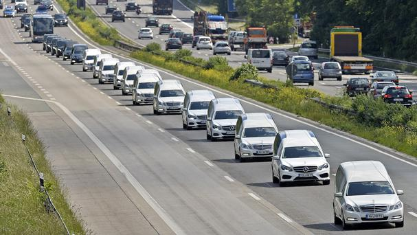 A convoy of hearses drives on the highway in Duisburg, Germany. (AP)
