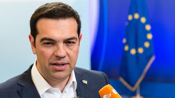 Greek Prime Minister Alexis Tsipras talks to the media after leaving a meeting with European Commission President Jean-Claude Juncker. (AP)