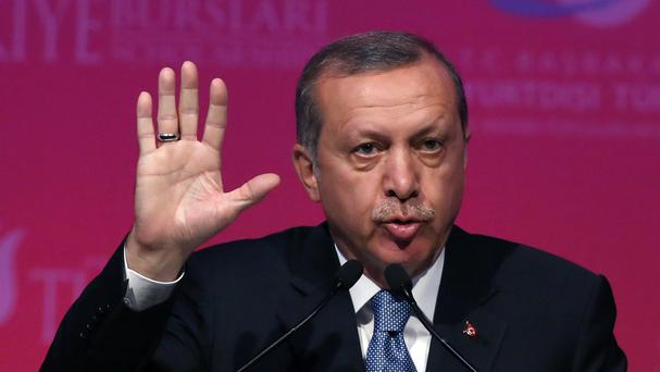 Turkey's president Recep Tayyip Erdogan has asked all political parties to put aside their differences and rapidly form a new government (AP)