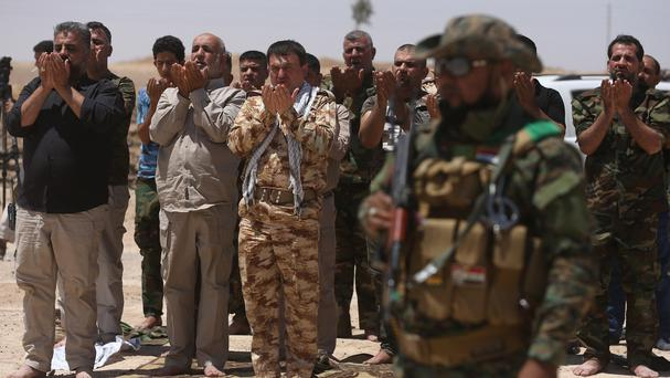 Iraqi forces, backed by Shiite militias, have been struggling to regain control of vast areas lost to the Islamic State group during its blitz last year (AP)