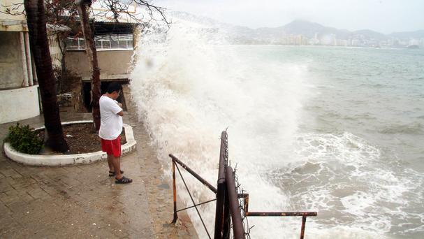 Waves crash against a sea wall in the Pacific resort city of Acapulco, Mexico (AP)