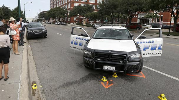 A police car with bullet holes in the windscreen after a gunman opened fire at Dallas Police headquarters. (AP)