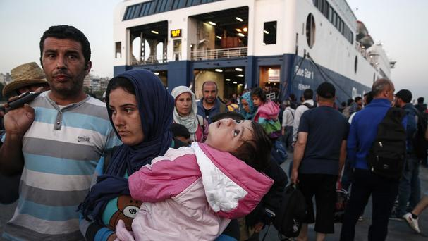 Migrants headed towards Athens after disembarking