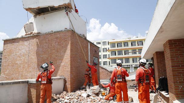 UK firefighters help to re-open a hospital in Kathmandu, Nepal, which was damaged by the earthquake (DfID/PA)