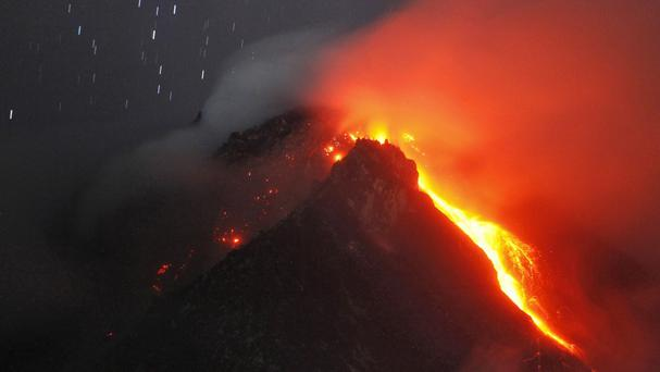 Hot lava flows from the crater of Mount Sinabung,Indonesia. (AP)