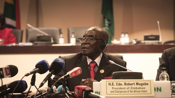 Zimbabwean president and chair of the African Unity Summit Robert Mugabe addresses delegates in Johannesburg (AP)