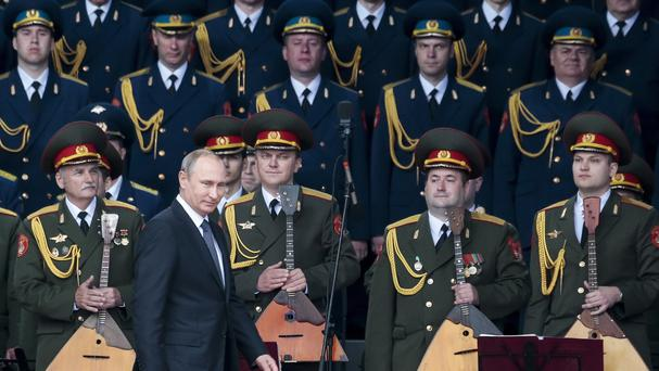 Russian president Vladimir Putin, foreground, leaves a podium after delivering his speech at the opening of the Army-2015 international military show (AP)