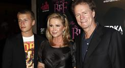 Conrad Hilton, left, with his parents Kathy and Rick (AP)