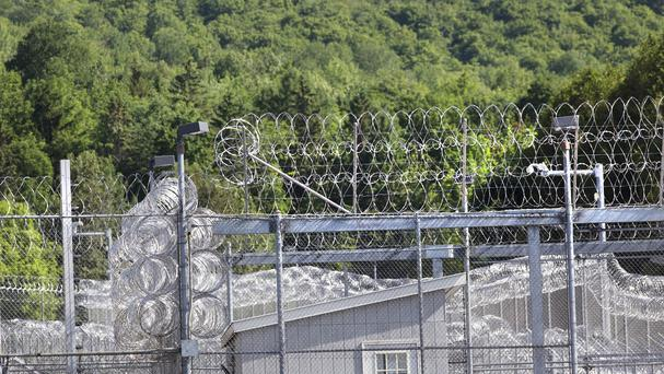 Thick woods line one side of the Clinton Correctional Facility in New York state. (AP)