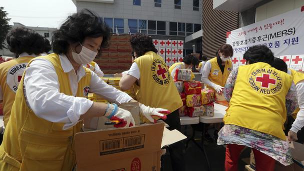 Members of South Korean Red Cross prepare relief items for people who are isolated at their home after having close contact with Mers patients. (AP)