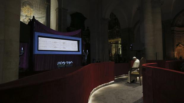 Pope Francis prays in front of the Holy Shroud (AP)