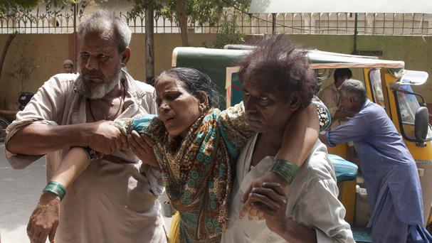 There no official tally of the deaths in Pakistan's southern city of Karachi, health officials said Credit: Akhtar Soomro