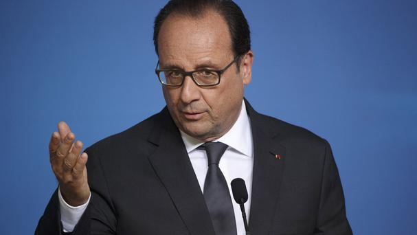 Francois Hollande is one of three French presidents who were spied on by the US, according to WikiLeaks (AP)
