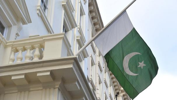 Officials in Pakistan have denied claims that an intelligence officer was involved in an attack on the Afghan parliament